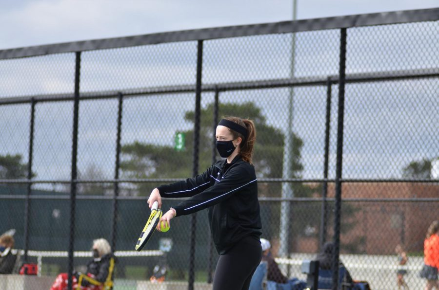 Lindsey Henkenius '22 prepares to serve to her opponent from Prairie April 15.