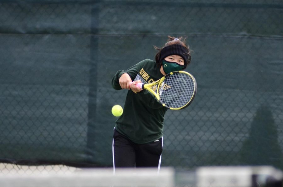 Lydia Shin '23 follows through with her swing to return the ball to Prairie's court April 15.