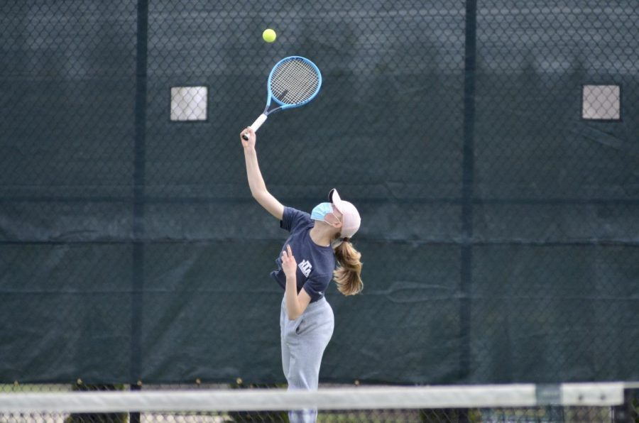 Lilly Graham '24 serves the ball April 15 to her opponent from Prairie.