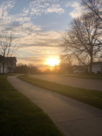 "The sun sets over Foxana Drive at 7:33 PM. A particular perk to spring that many look forward to are the longer days caused by the Earth's tilt towards the sun. ""My mood is always higher when the days are longer"" Christina Weitz an ELL teacher at West says."