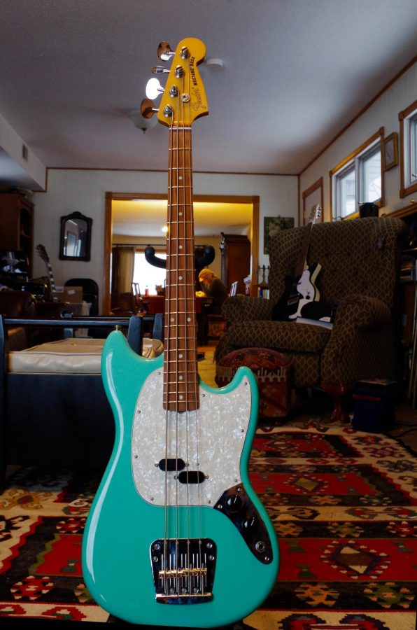 Gwen Watson bought their Fender Mustang 60s' Vintera Bass at a guitar center in Nashville. They bought it so they wouldn't have to use synths for any bass they wanted to add to their songs.