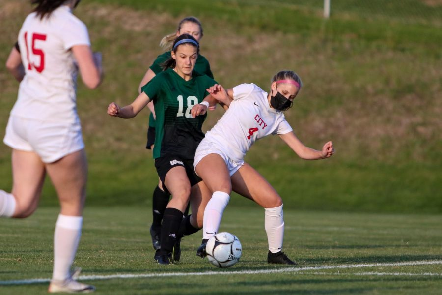 Aly Skala '24 looks for a steal on the defensive end against City High at Ed Barker Field on April 22.