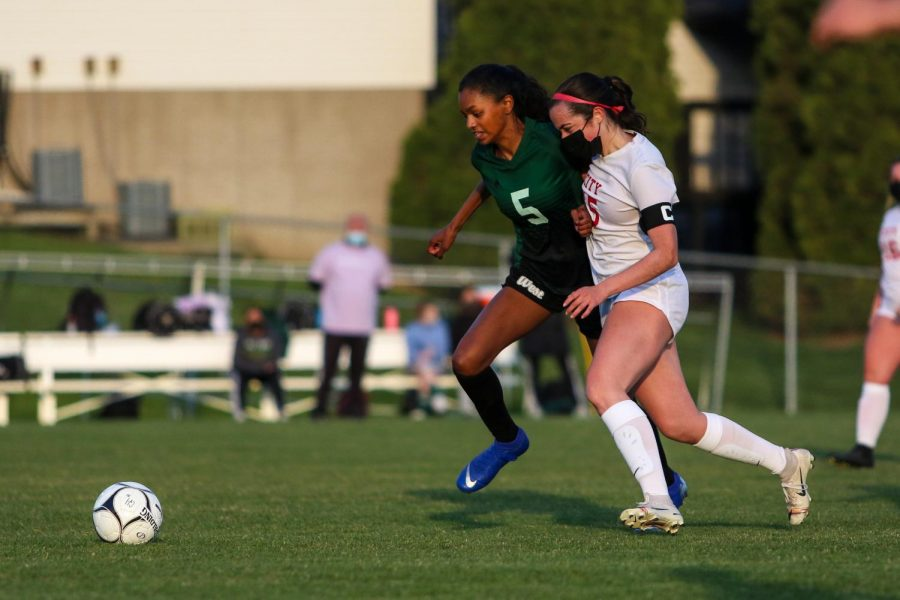 Meena Tate '23 chases down a loose ball against City High at Ed Barker Field on April 22.