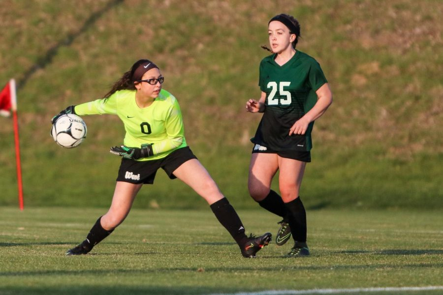 Goalkeeper Julia Bernat '21 looks to throw the ball ahead to one of her teammates against City High at Ed Barker Field on April 22.