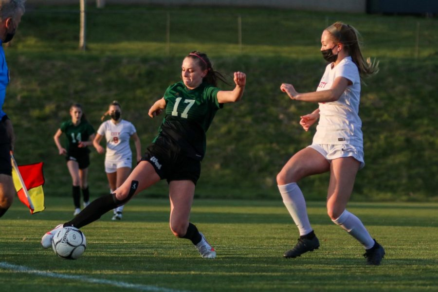 Grace Curran '21 reaches to keep the ball inbounds against City High at Ed Barker Field on April 22.