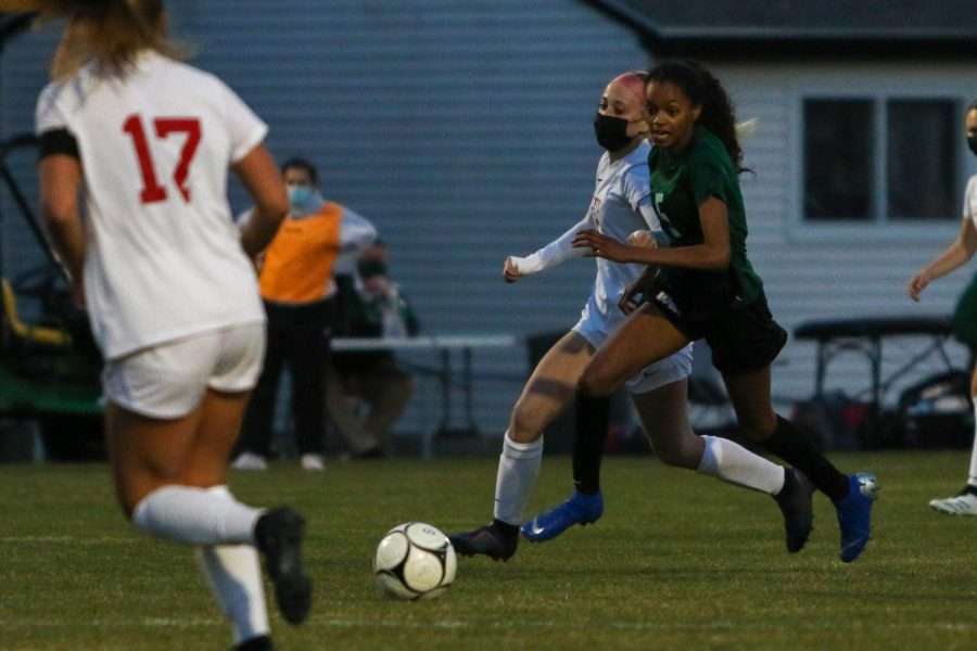 Meena Tate '23 eyes the ball on a break away against City High at Ed Barker Field on April 22.