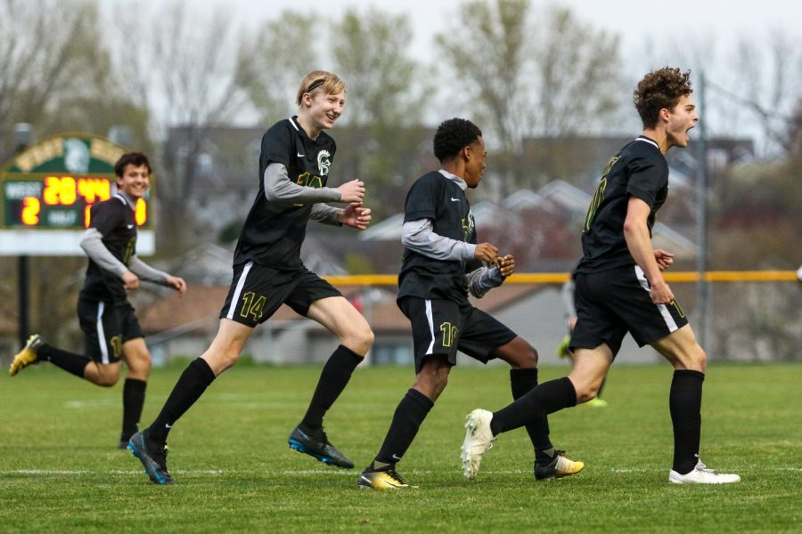 Owen Smith '21 yells out of excitement after heading the ball into the back of the net against City High at Ed Barker Field on April 23.