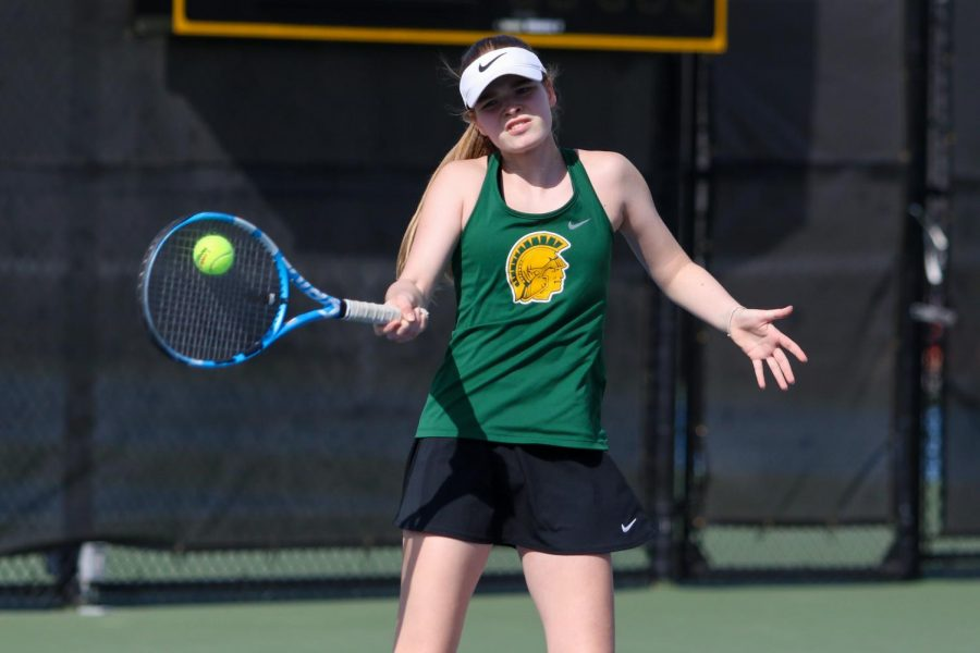 Ella De Young '23 defends her side of the court against City High at the Hawkeye Tennis and Recreation Center on April 29.