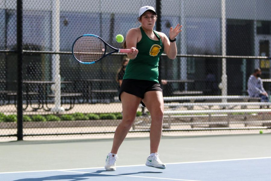 Sophomore Zola Gross looks to score on a return against City High at the Hawkeye Tennis and Recreation Center on April 29.