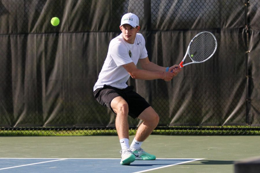 BJ Wolf '21 waits to backhand the ball to the other side of the court against City High at the Hawkeye Tennis and Recreation Center on April 29.