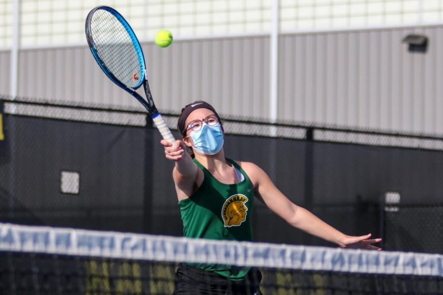 Julianna Mascardo '23 reaches to make a play on the ball against City High at the Hawkeye Tennis and Recreation Center on April 29.