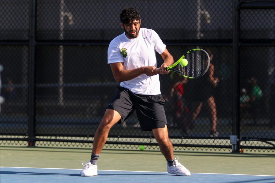 Mukundan Kasturirangan '21 backhands the ball as he looks to score against City High at the Hawkeye Tennis and Recreation Center on April 29.