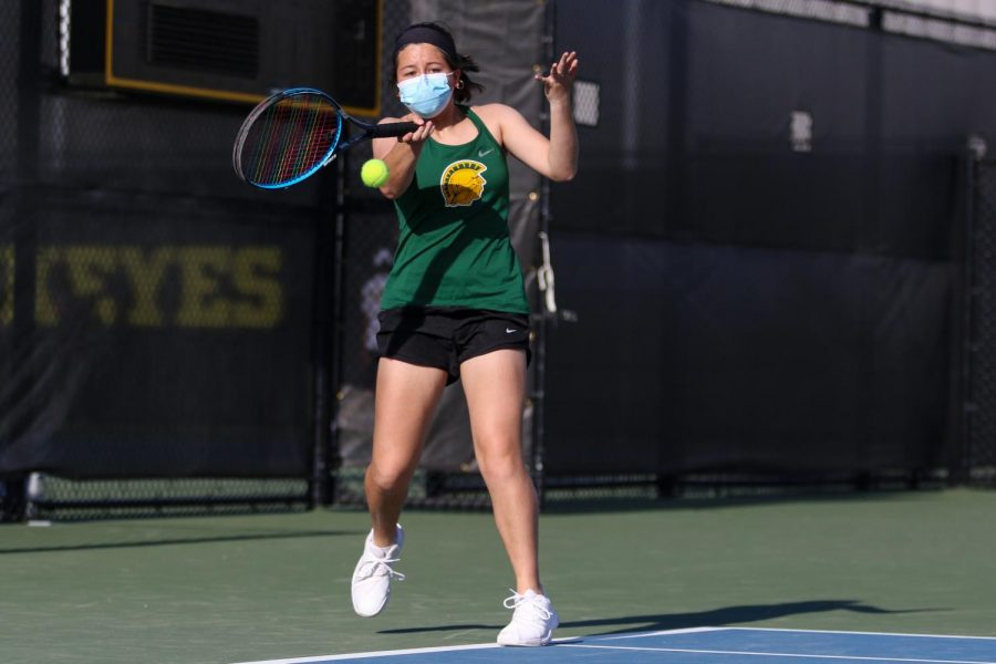 Caroline Mascardo '22 takes a swing at the ball as she looks to score against City High at the Hawkeye Tennis and Recreation Center on April 29.