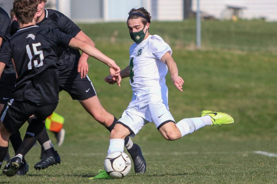 Miguel Cohen Suarez '22 takes a shot after getting past his defender against Ankeny Centennial on April 3 during the Iowa City West Classic.
