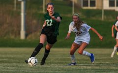 Makenna Vonderhaar 22 gets past her defender as she looks to pass against Ankeny on April 6.