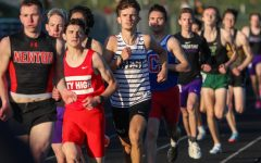 Caden Noeller 22 settles into the pack while running the 800 meter race during the Eastern Iowa Track and Field Festival on April 12.