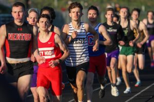 Caden Noeller '22 settles into the pack while running the 800 meter race during the Eastern Iowa Track and Field Festival on April 12.