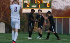 Miguel Cohen Suarez 22, Michael Nelson 23 and Marko Migambi 21 celebrate a goal towards the end of the first half against Liberty on April 13.