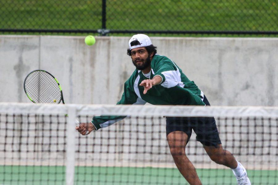 Mukundan Kasturirangan '21 looks to score while playing singles against Cedar Rapids Washington on April 14.