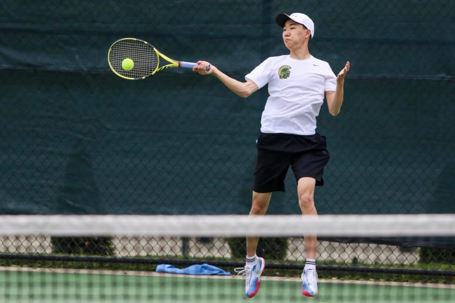 Jayden Shin '23 takes a forehand shot from the corner of the court while playing against Cedar Rapids Washington on April 14.