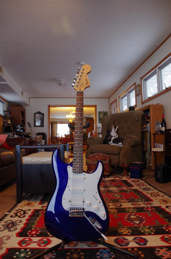 The Fender Squire Stratocaster is Gwen Watson's first electric guitar. Their dad bought it for them as a Christmas present in 2011.