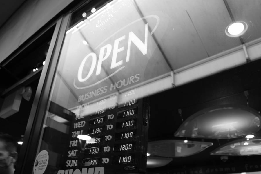 The open sign from Aspen Leaf Frozen Yogurt in downtown Iowa City on April 5. This is a B&W photo I took from a worm's view.