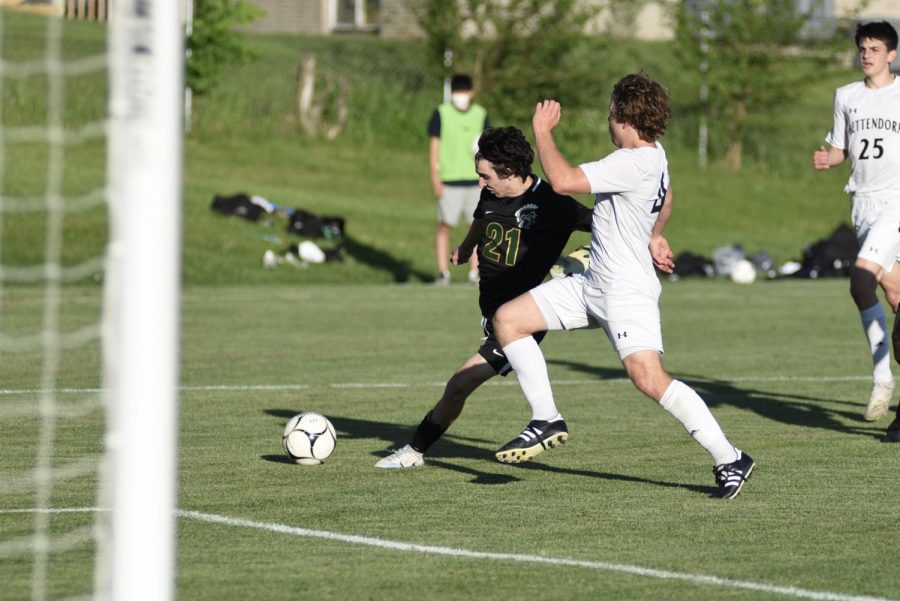 Micheal Nelson '23 looks to take a shot against Bettendorf during the Sub-State final game on May 26.