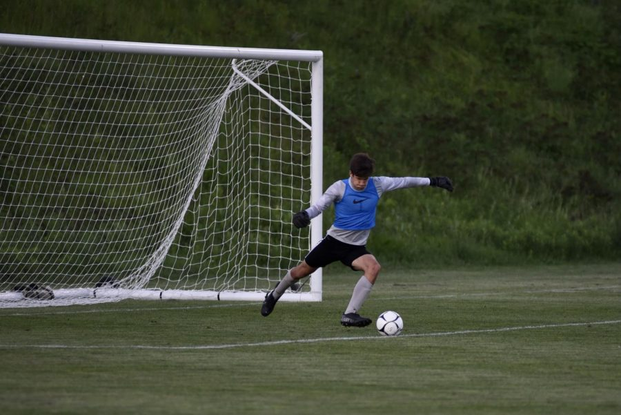 Nicholas Mcdonnell '22 puts the ball back in play after a failed goal attempt by Bettendorf on May 26.