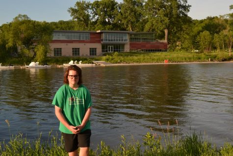 Cormac Nabhan-Warren '22 stands outside of the Beckwith Boathouse where he will row over the summer.