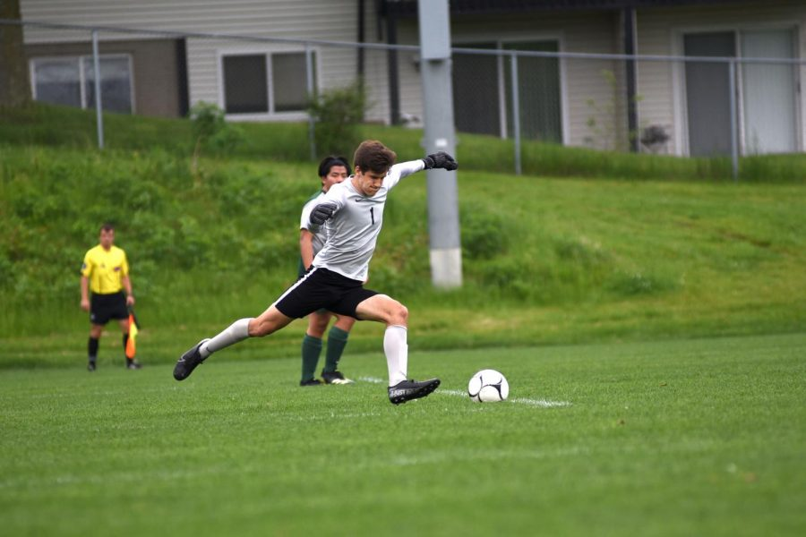 Keeper Nick McDonnell 22 puts the ball back into play as he defends the goal from North Scott.