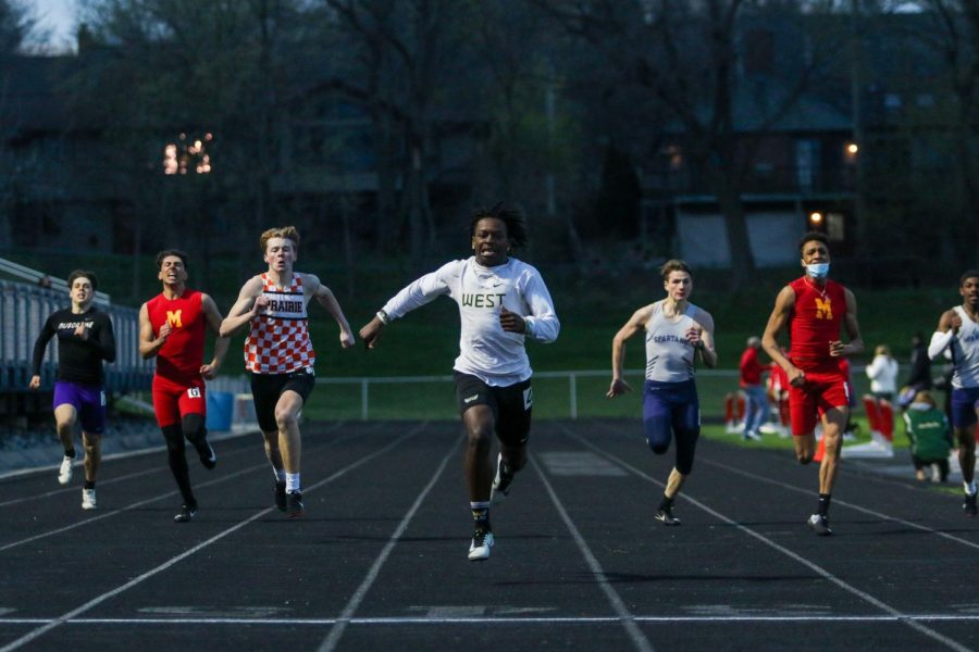 Fabian Brown '21 inches towards the finish line while running the 200-meter dash on April 15 at the Forwald Coleman Relays.