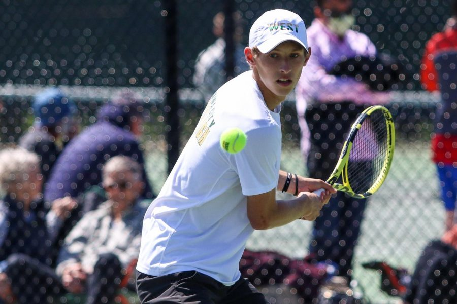 Eli Young '21 eyes the ball as he prepares to make a play while playing singles at the IHSAA Boys District Tennis tournament on May 12.