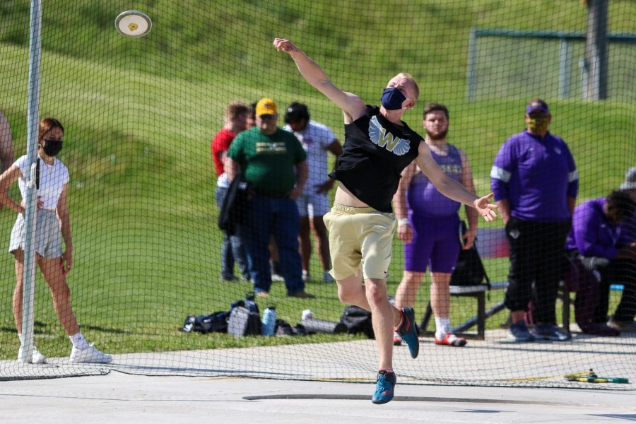 Tyler Halverson '21 launches the disk into the air while competing in the discus at the Class 4A district track and field meet on May 13.