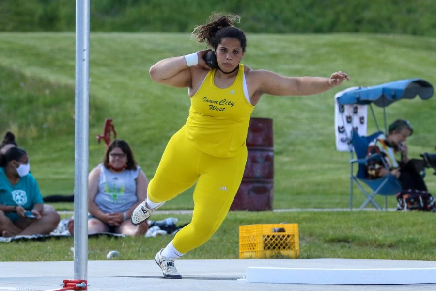 Phoebe Burt '21 winds up to throw the shot put at the Class 4A district track and field meet on May 13.