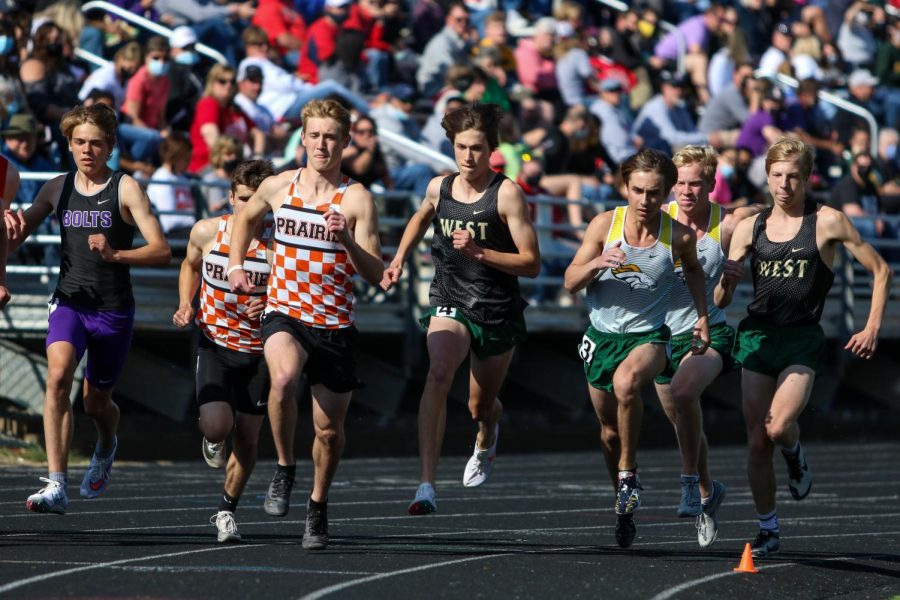 Alex McKane '22 and Seth Cheney '23 try to separate from the crowd at the start of the 3200-meter race at the Class 4A district track and field meet on May 13.