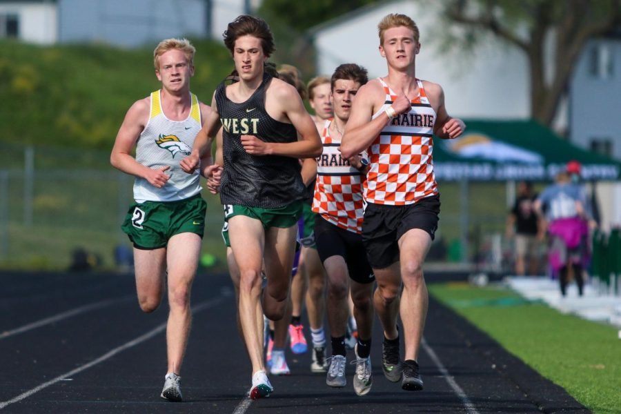 Alex+McKane+%2722+leads+the+pack+while+running+the+3200-meter+race+at+the+Class+4A+district+track+and+field+meet+on+May+13.