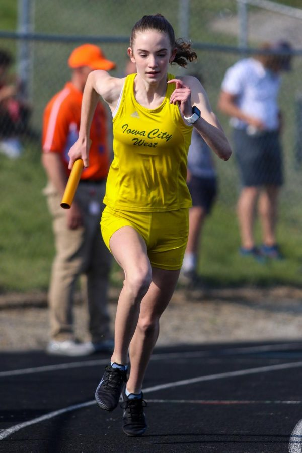 Annie Schwartz '23 strides out at the start of the 4 by 800-meter relay at the Class 4A district track and field meet on May 13.