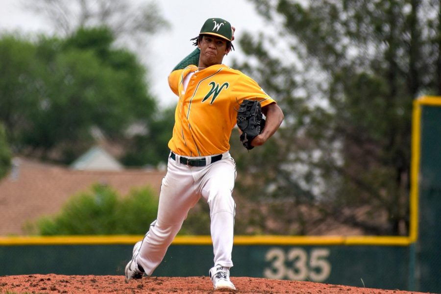 Marcus Morgan 21 delivers a pitch in the Trojans season opener against Bettendorf on May 24.