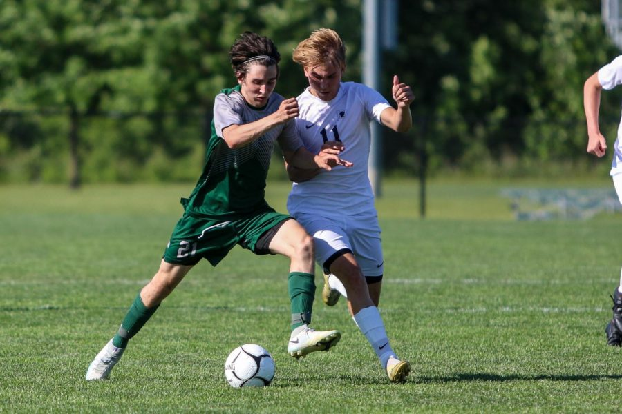 Michael Nelson '23 fights for possession against Pleasant Valley in the state championship game on June 5 in Des Moines.