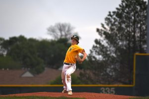 Noah DeSaulniers '22 concentrates while he pitches the ball.