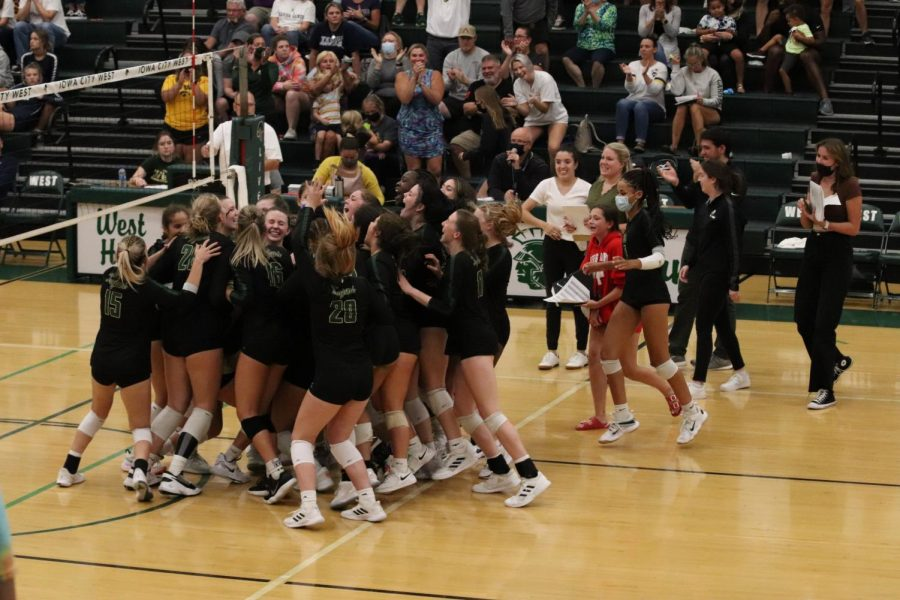 West volleyball celebrates victory against Xavier Saints.
