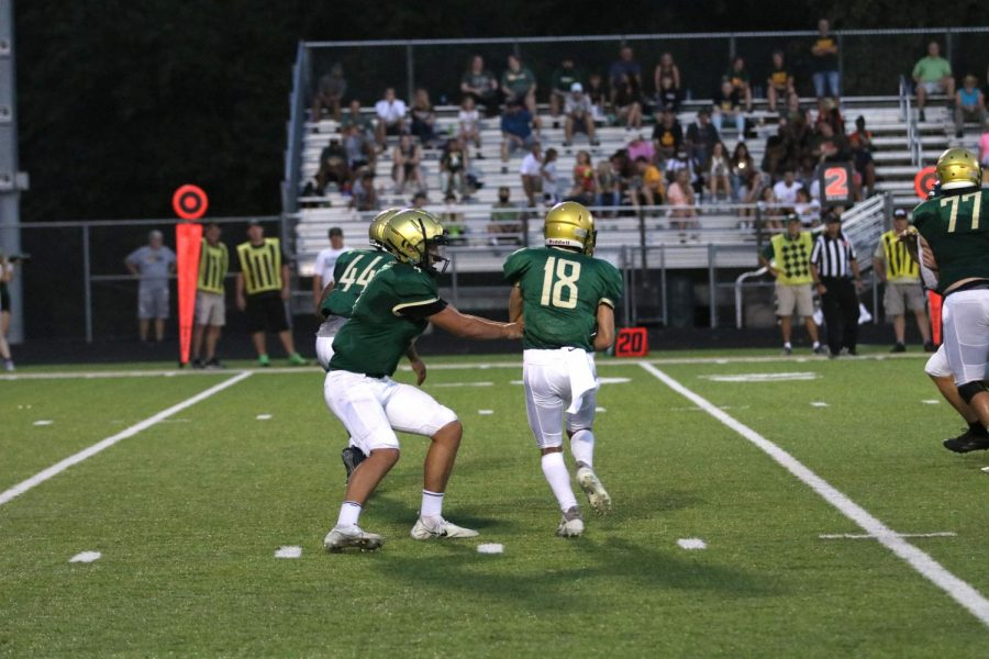 Jack Wallace 25 passes the ball off to Nate Gudenkauf 22 during a game against Kennedy.