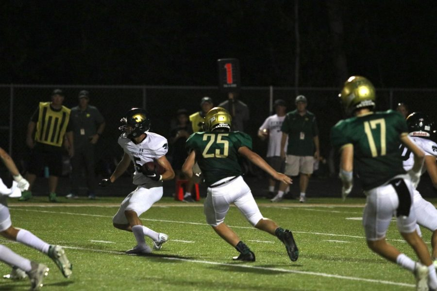 TJ Donovan 23 chases after Kennedy receiver Jeron Senters 22.