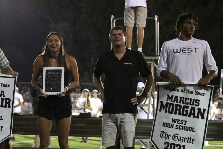 Former Trojans Aurora Roghair 21 and Marcus Morgan 21 are announced as The Gazette Athletes of the Year at the season-opening football game.