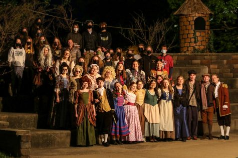 """The Theatre West cast and crew poses for a picture after being a part of """"Into the Woods"""" in the West High courtyard on May 13."""