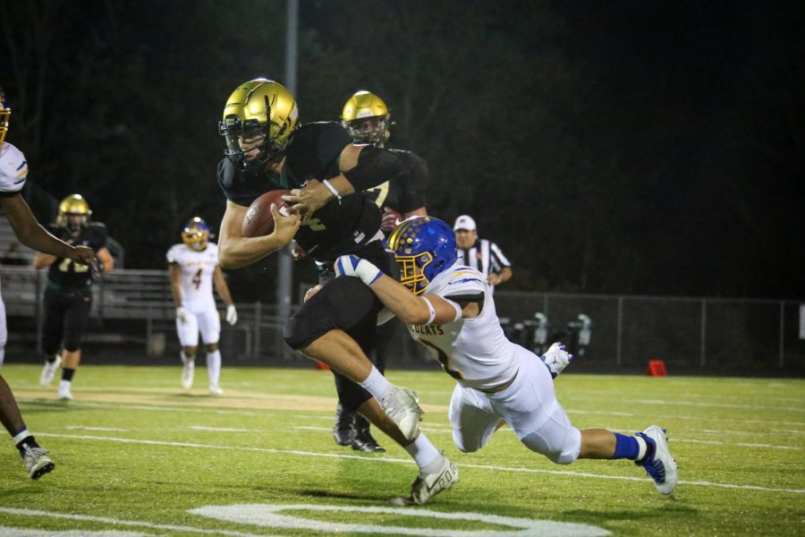 Jack Wallace 25 fights for a first down against Davenport North on Sept. 17.