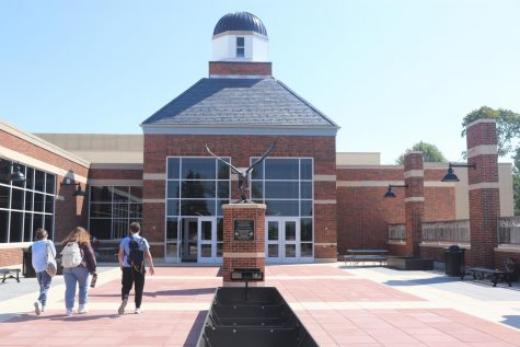 Outside the new lunch room in City High is an entrance way with a Little Hawk statue standing proudly in the center. This statue was donated by a family in  memory of Calder Wells and other students who have passed away.