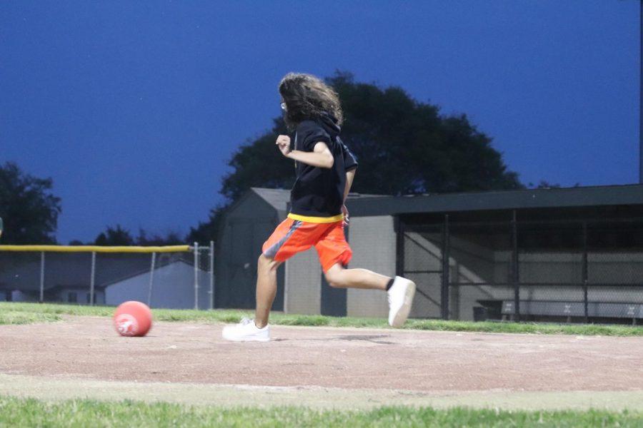 Senior Alex Moore runs at their pitch in the first annual  Trojan Games