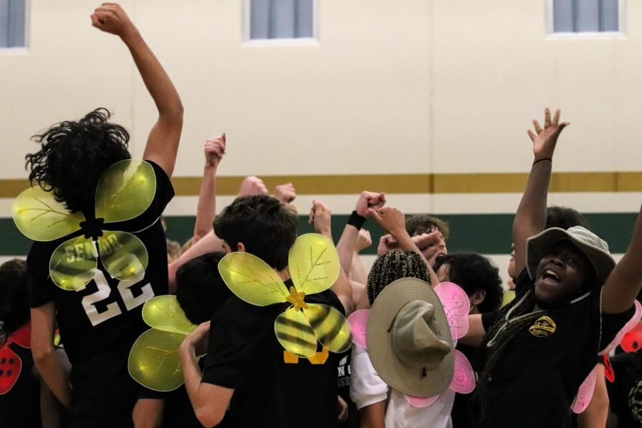 Senior Mayowa Dokun 22 hypes up her volleyball team for the Trojan Games.