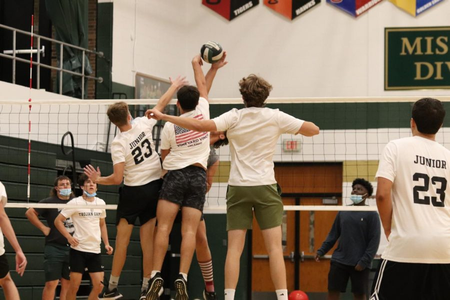 This junior team strategically placed their tallest players to block the other teams hit.